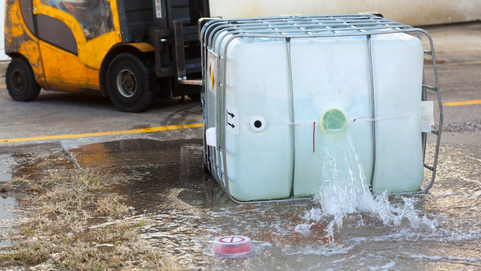 Dangerous Chemicals Spilling From Container Stock Photo