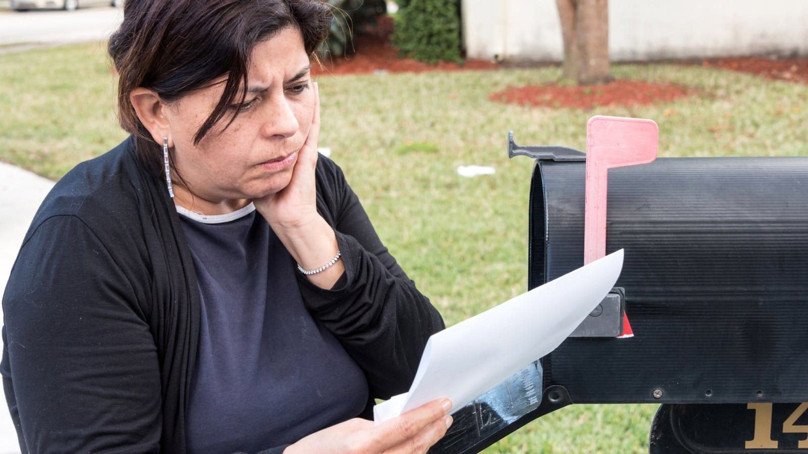 Woman Reading Denied SSDI Claim Stock Photo