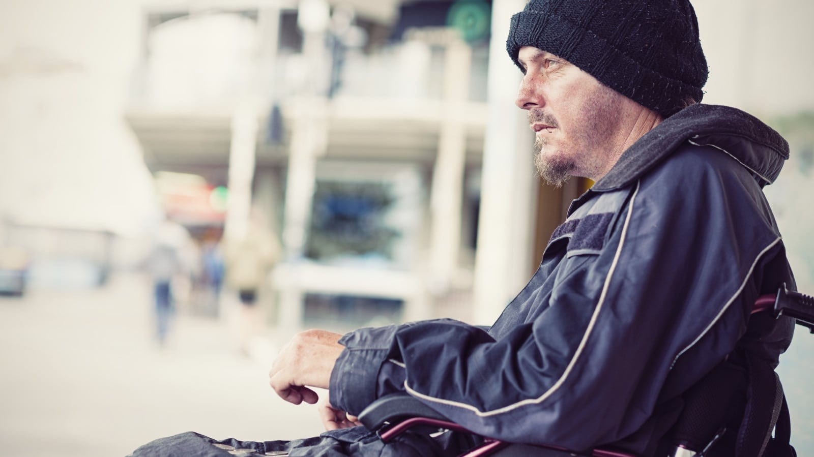 Disabled Man Sitting In Wheelchair Outdoors Stock Photo