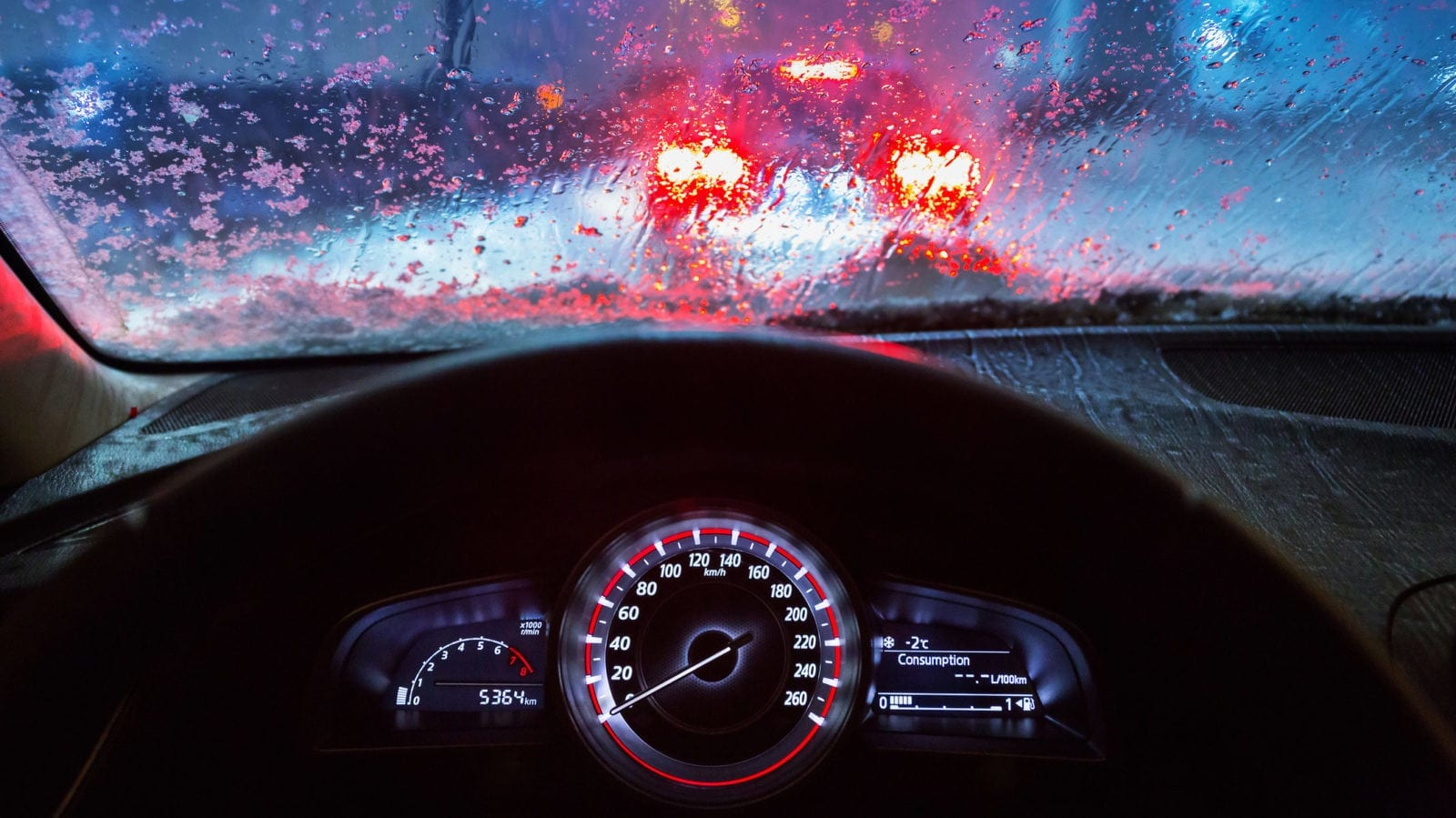 Man Driving His Car During Heavy Rainfall Stock Photo