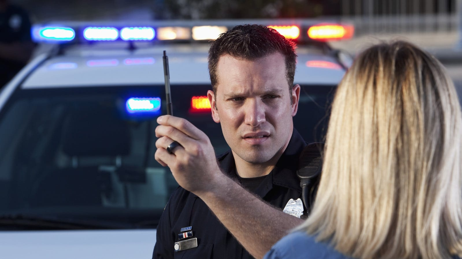 Police officer conducting sobriety test stock photo