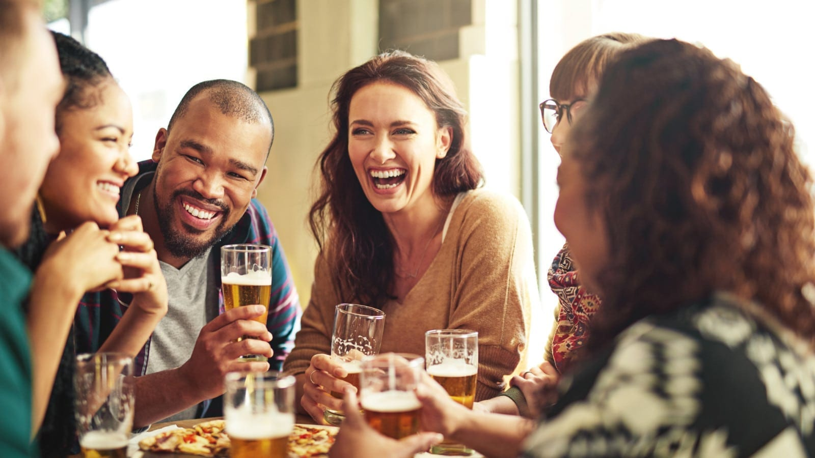 Group Of Friends Meeting At A Pub Stock Photo