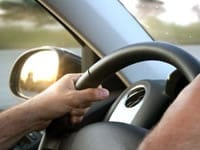 Hands On A Steering Wheel Stock Photo