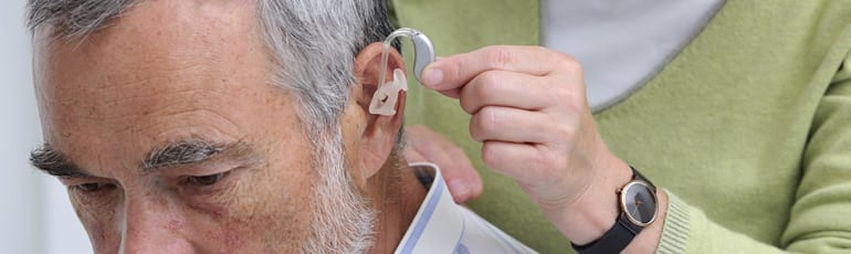 Elderly Man Wearing Hearing Aids Stock Photo
