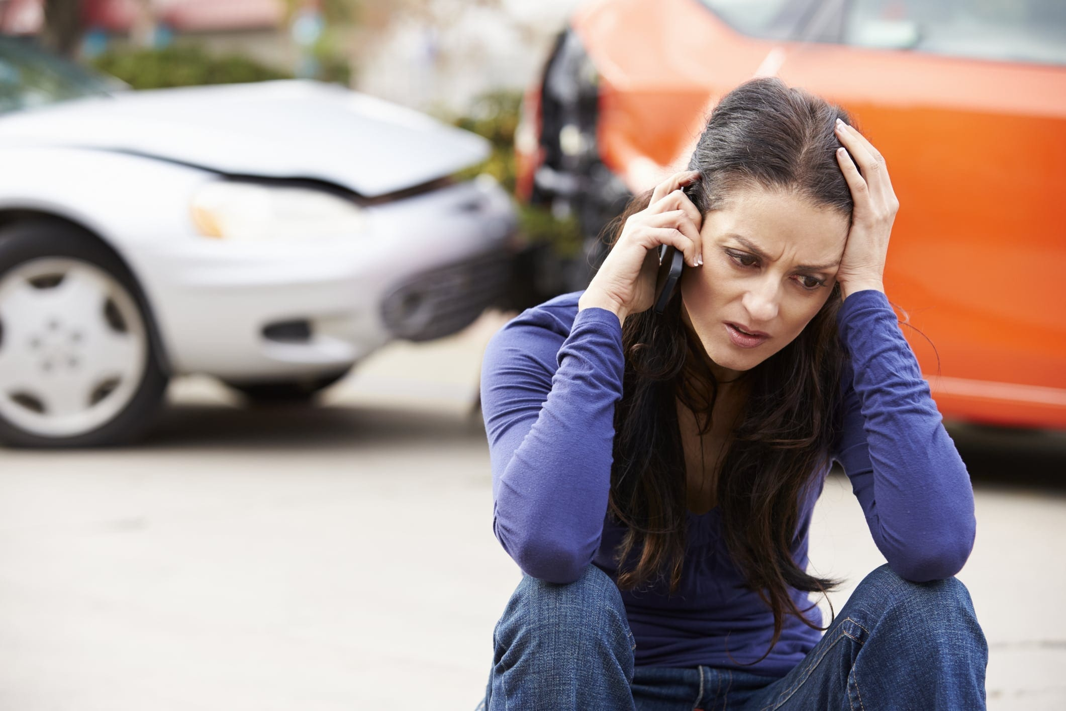 Female Driver Making Phone Call After Car Accident Stock Photo