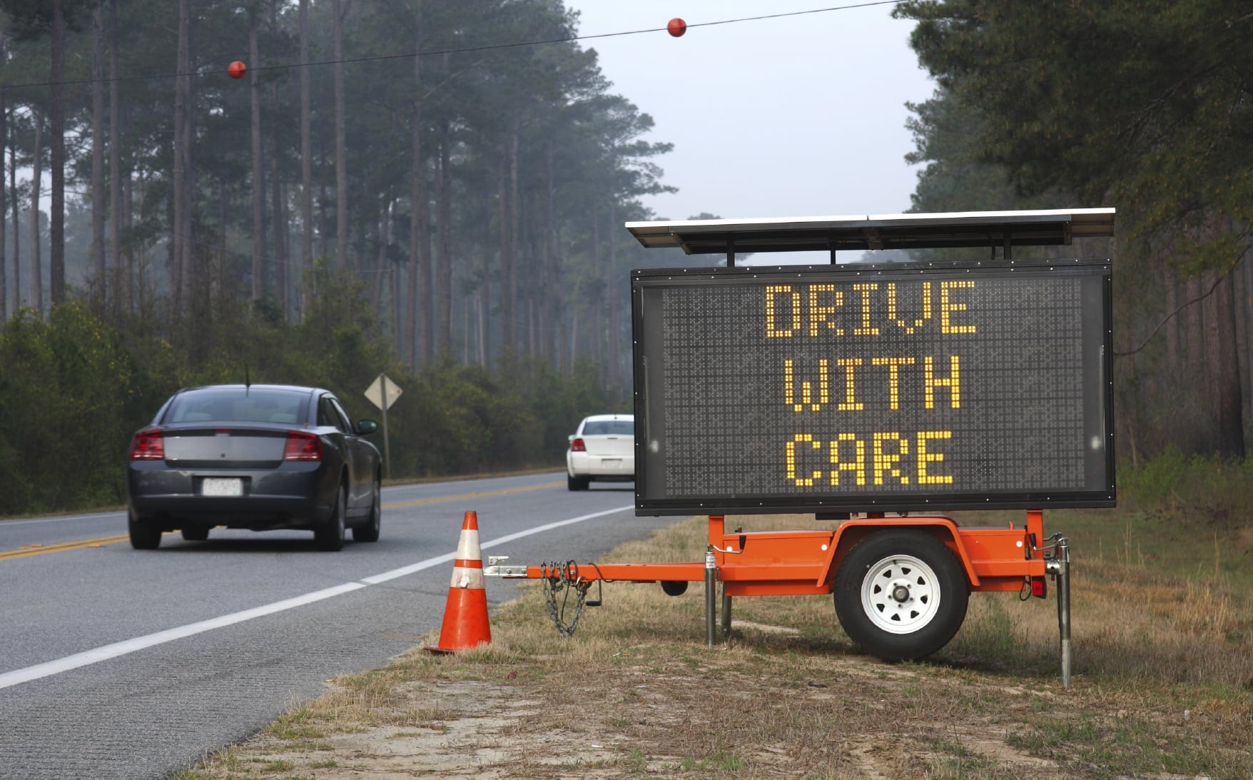 Drive With Care Warning Sign Stock Photo