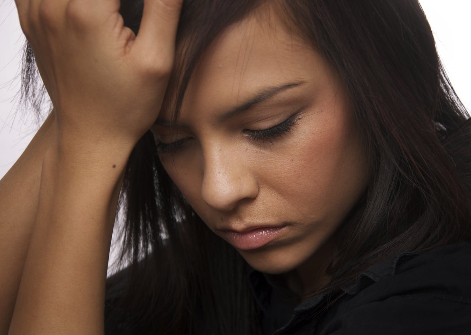 Worried Young Woman Stock Photo