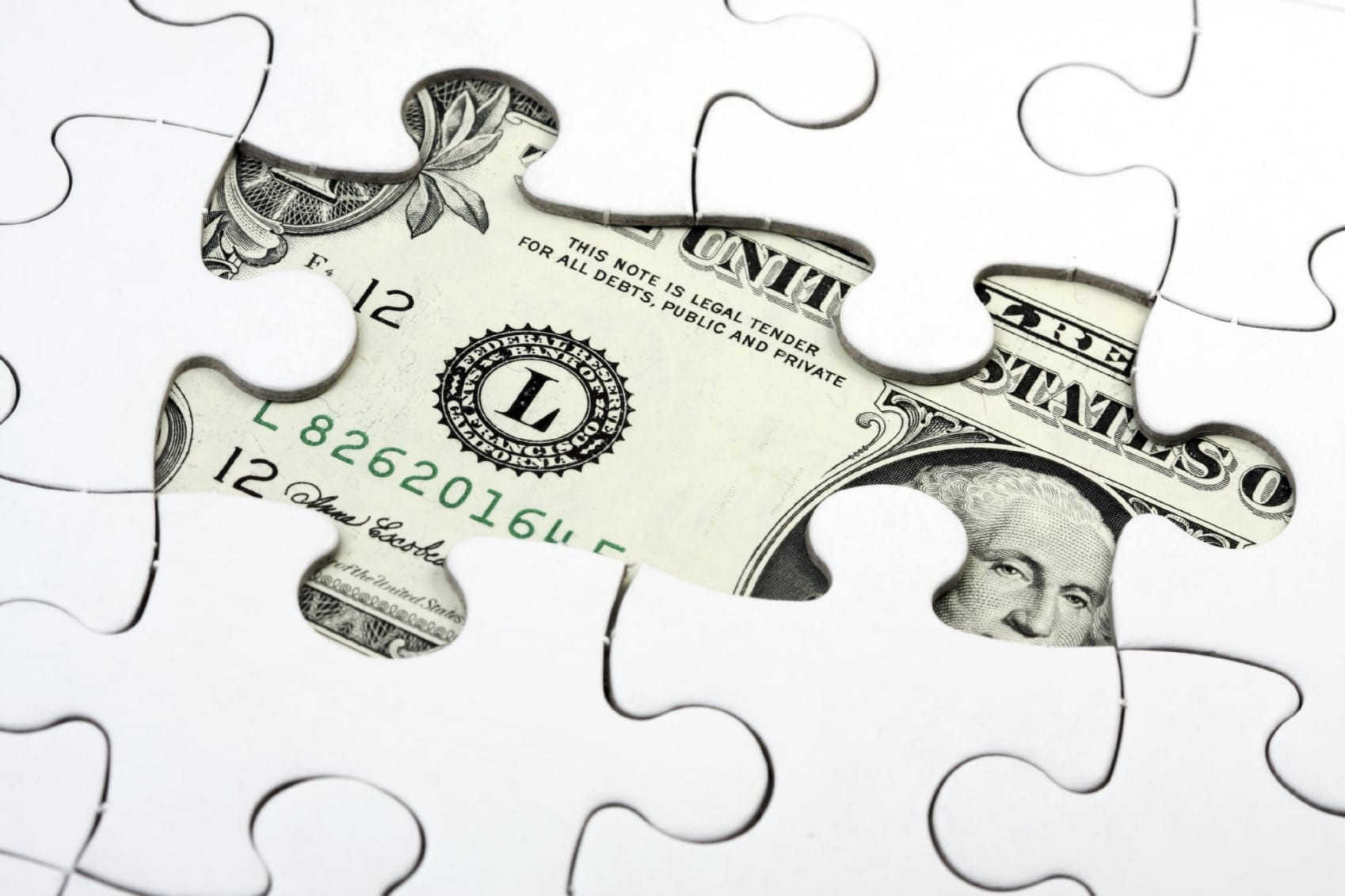Puzzle With American Currency Stock Photo