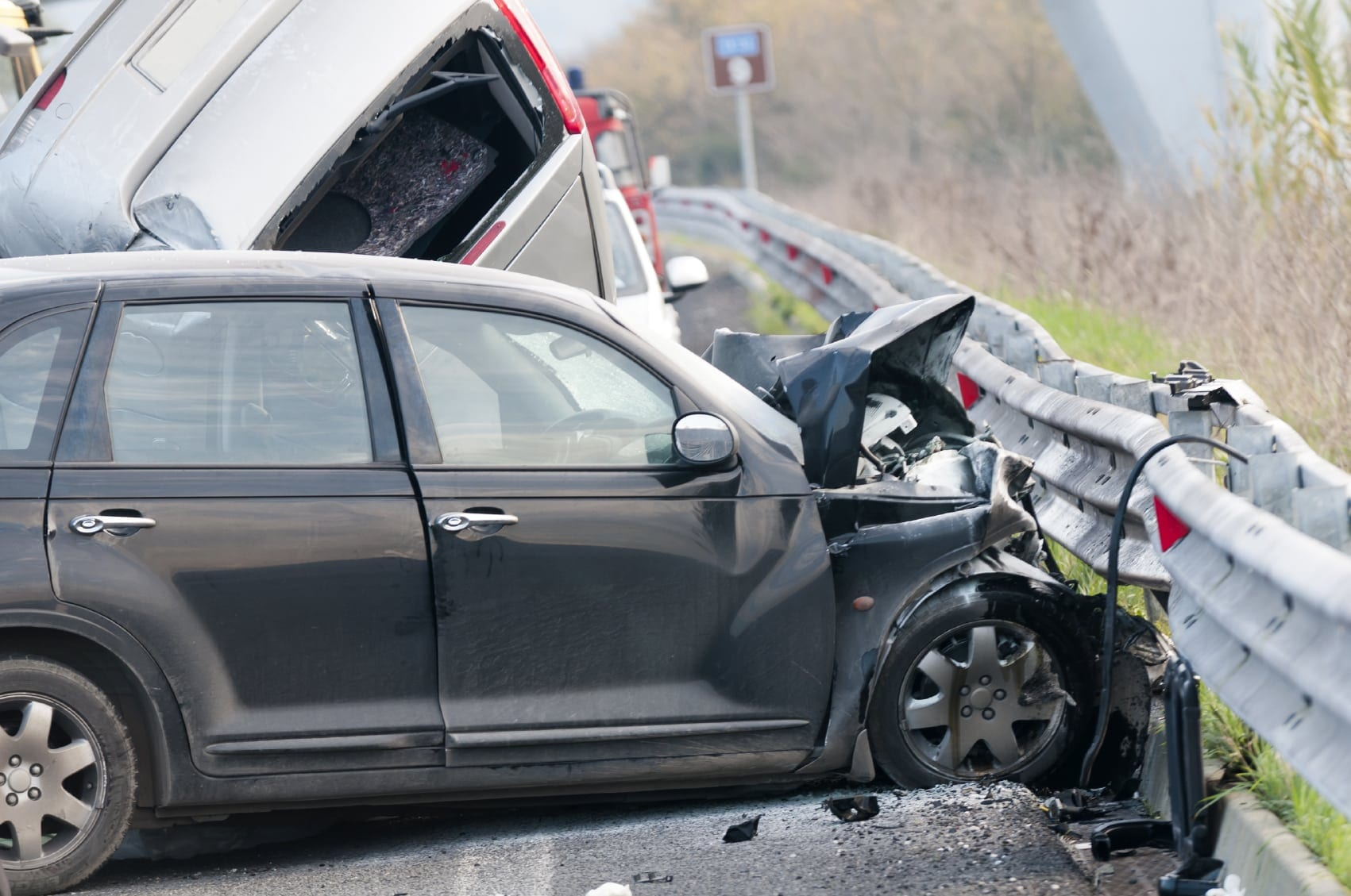 Car Accident Against Guardrail Stock Photo
