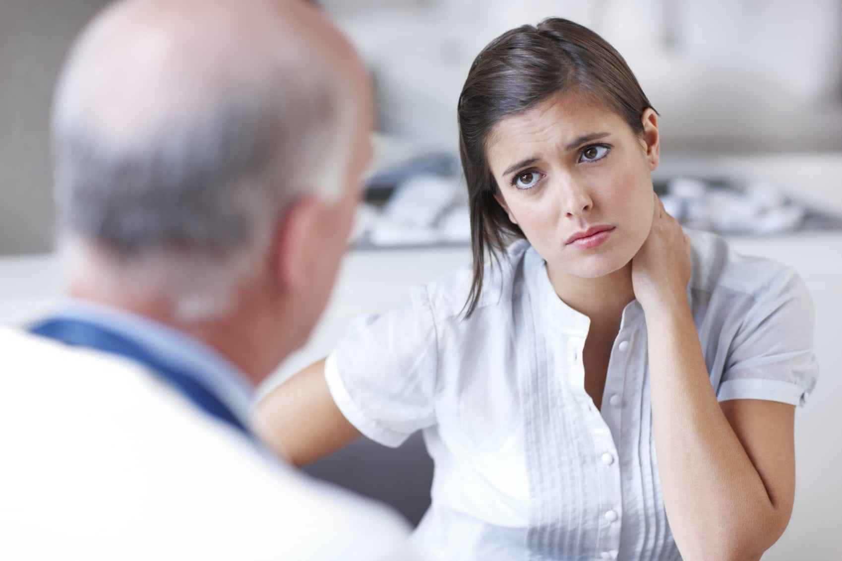 Young Woman Meeting With A Physician Stock Photo