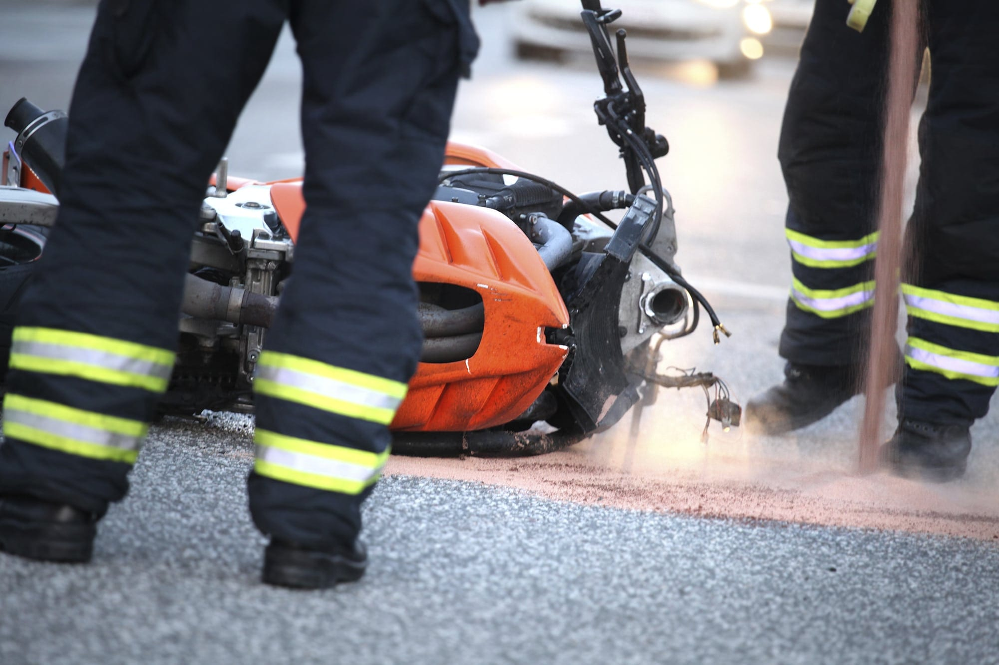 Firefighters Responding To Motorcycle Accident Stock Photo