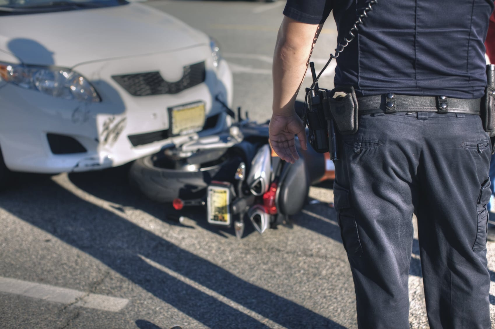 Police Officer Inspecting Motorcycle Accident Stock Photo