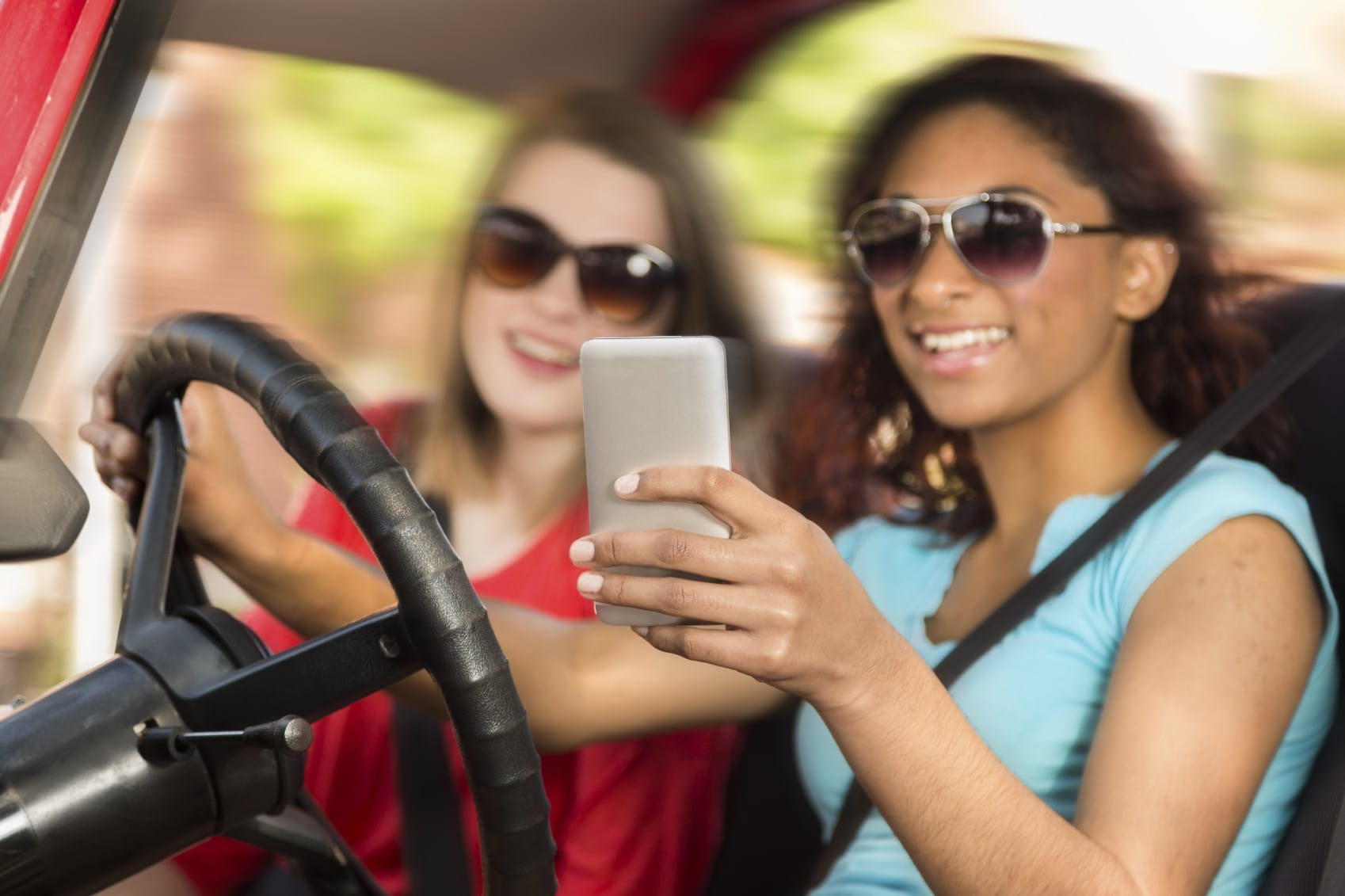 College-aged Girls Texting While Driving Stock Photo