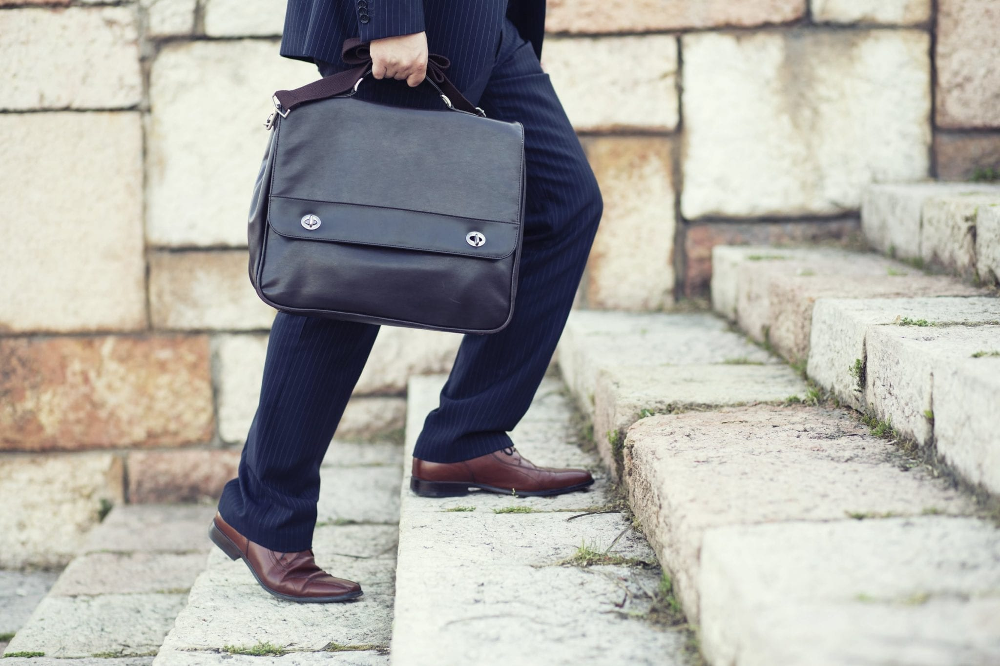 Lawyer In Suit Carrying Legal Briefcase Stock Photo