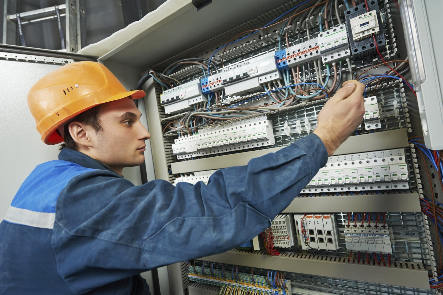 Electrician Working With Wiring Stock Photo