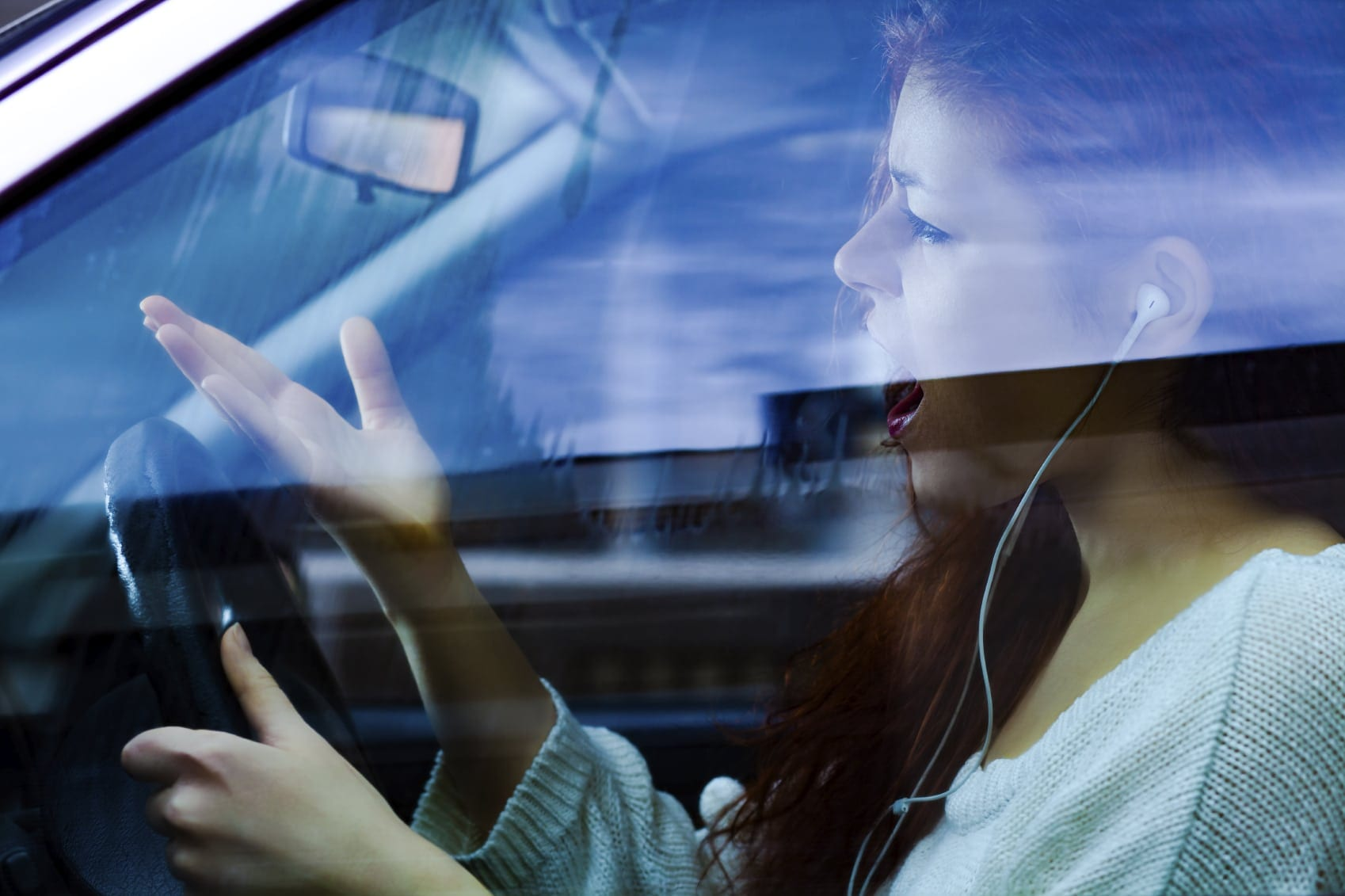 Young Woman Expressing Rage While Driving Stock Photo
