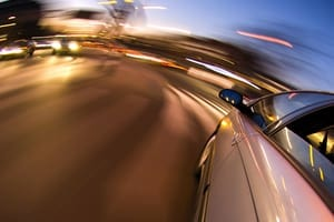 Car Driving At High Speeds Stock Photo