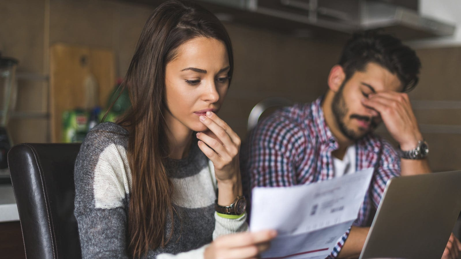 Distressed Couple Reviewing Billing Statements