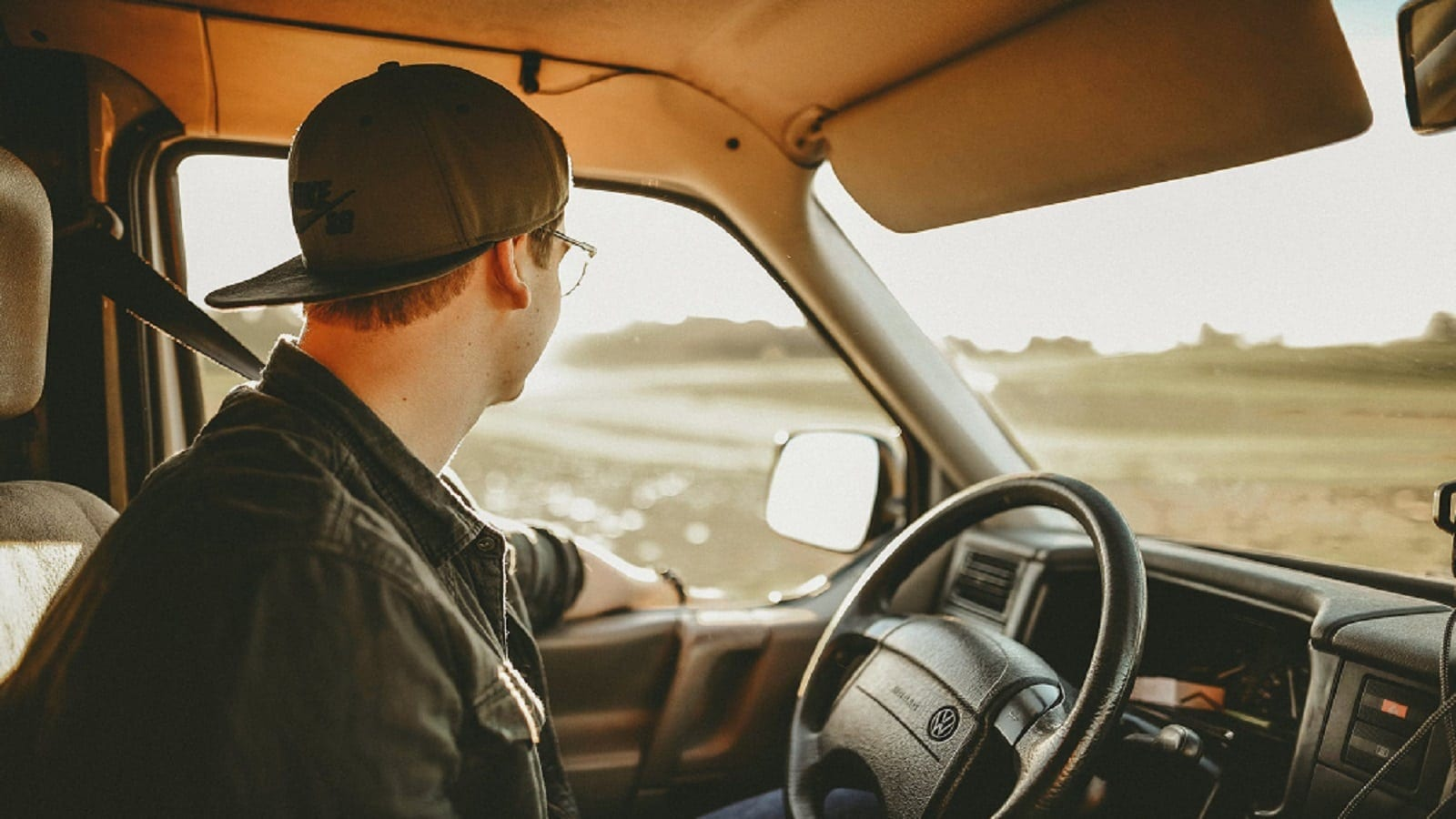 Young Man Driving His Pickup Truck Stock Photo