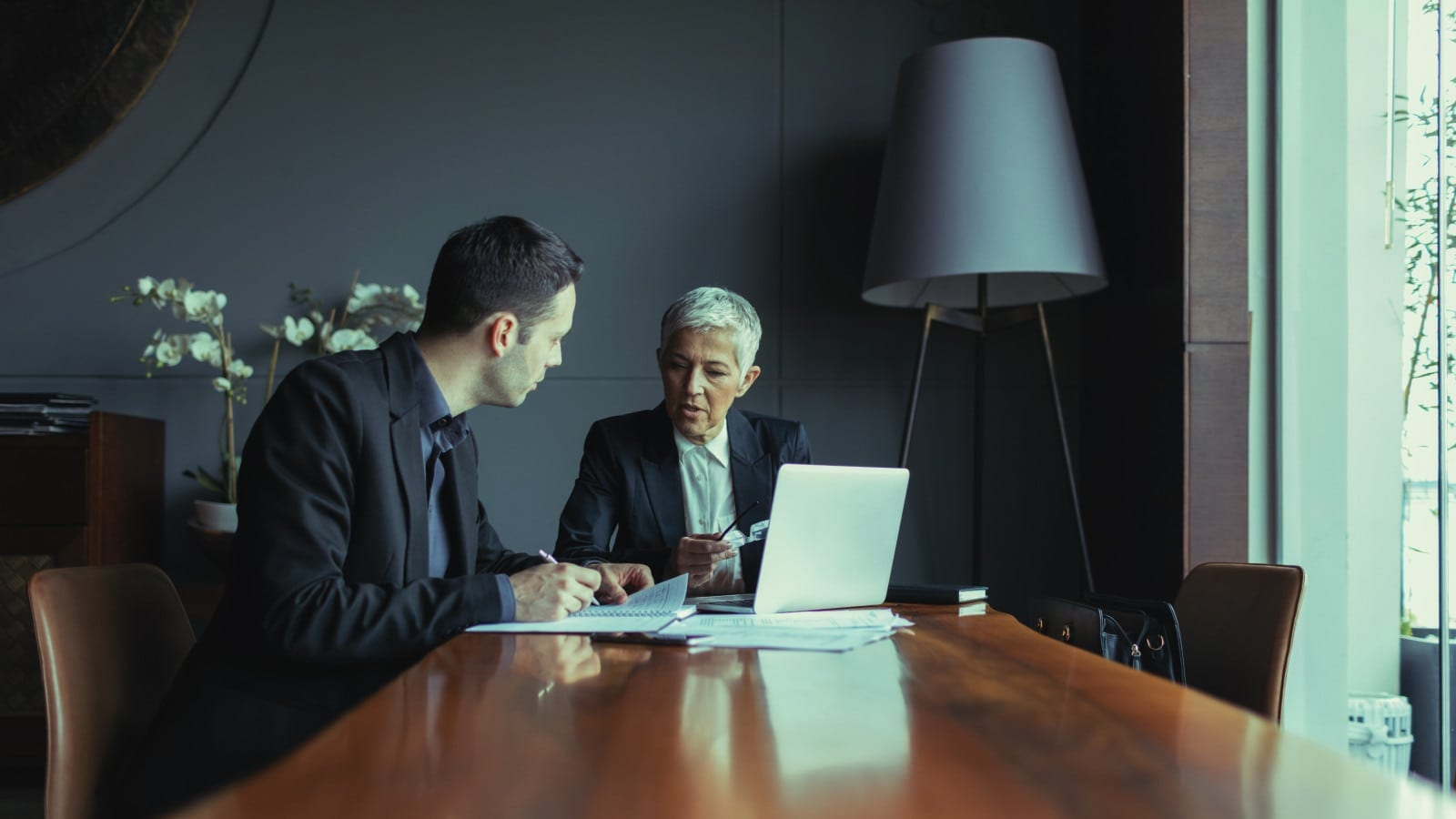 Two Personal Injury Lawyers Meeting Privately Stock Photo