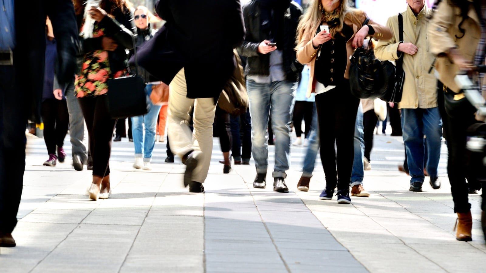Pedestrians Walking On A City Sidewalk Stock Photo