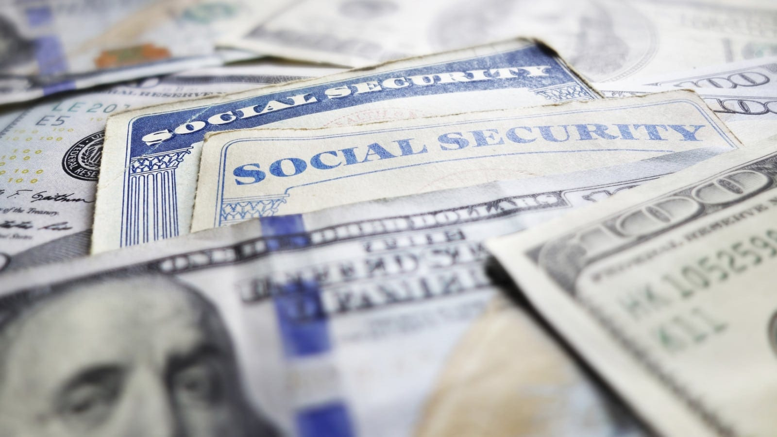 $100 Bills With Social Security Cards Stock Photo