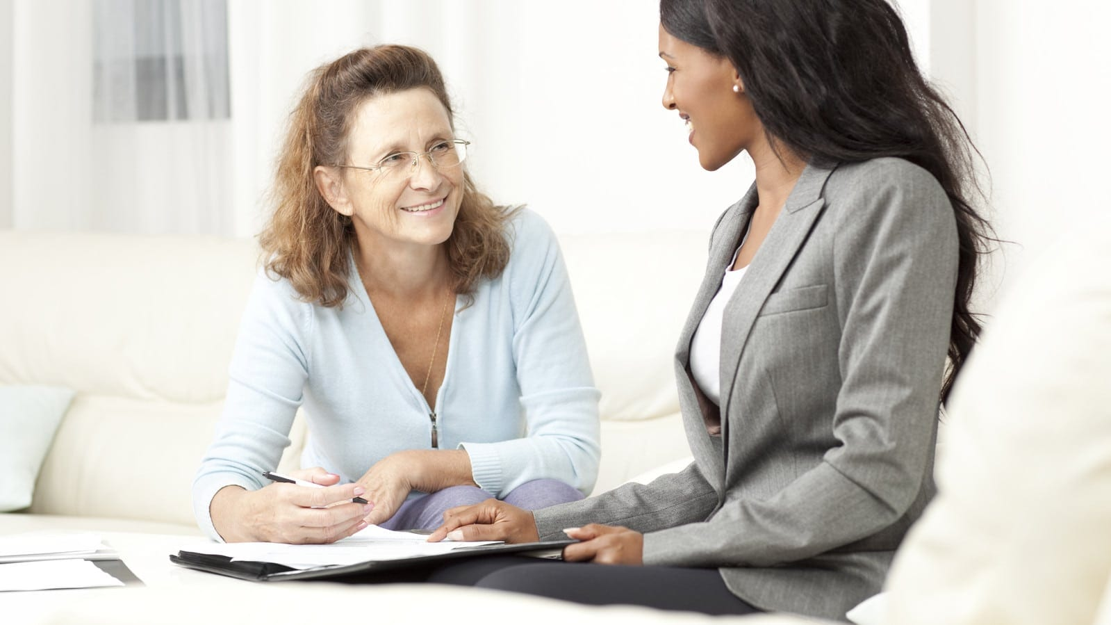 Social Security Disability Lawyer Meeting With A Female Client
