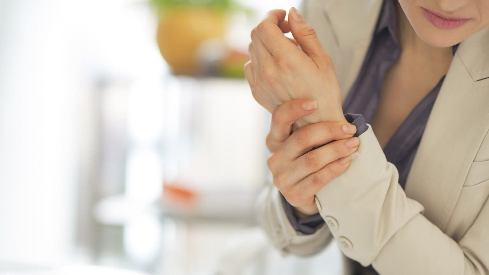 Young Female Worker With A Wrist Injury Stock Photo
