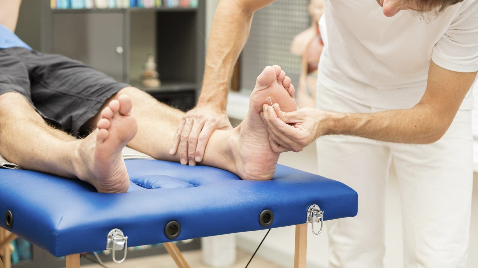 Foot Being Examined By Medical Professional Stock Photo