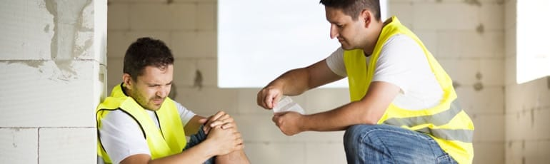 Injured Blue Collar Worker Stock Photo