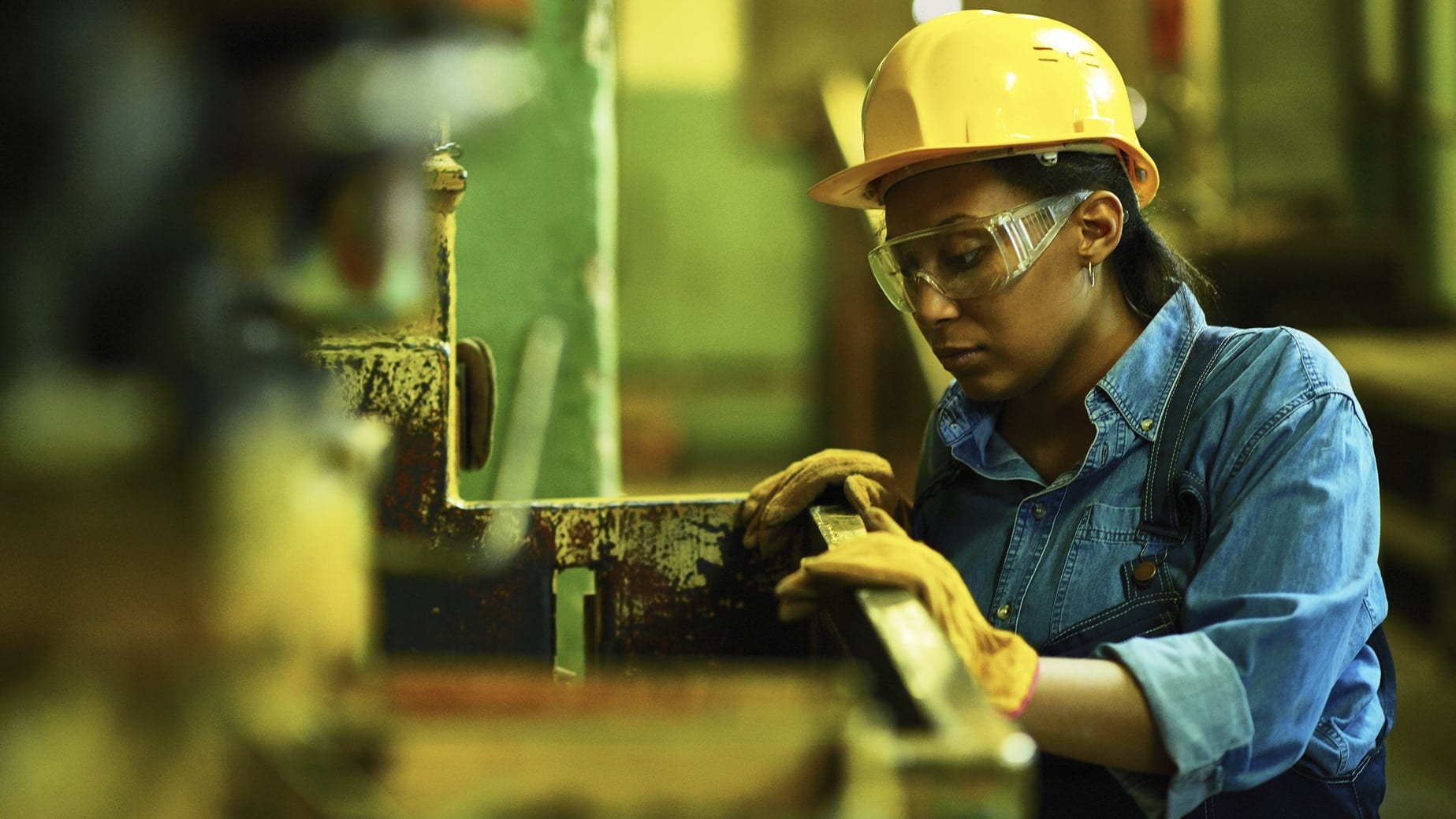 Female Worker In A Hard Hat Stock Photo